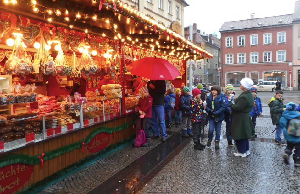 Local school kids head straight to the candy seller at the Bamberg Christmas market