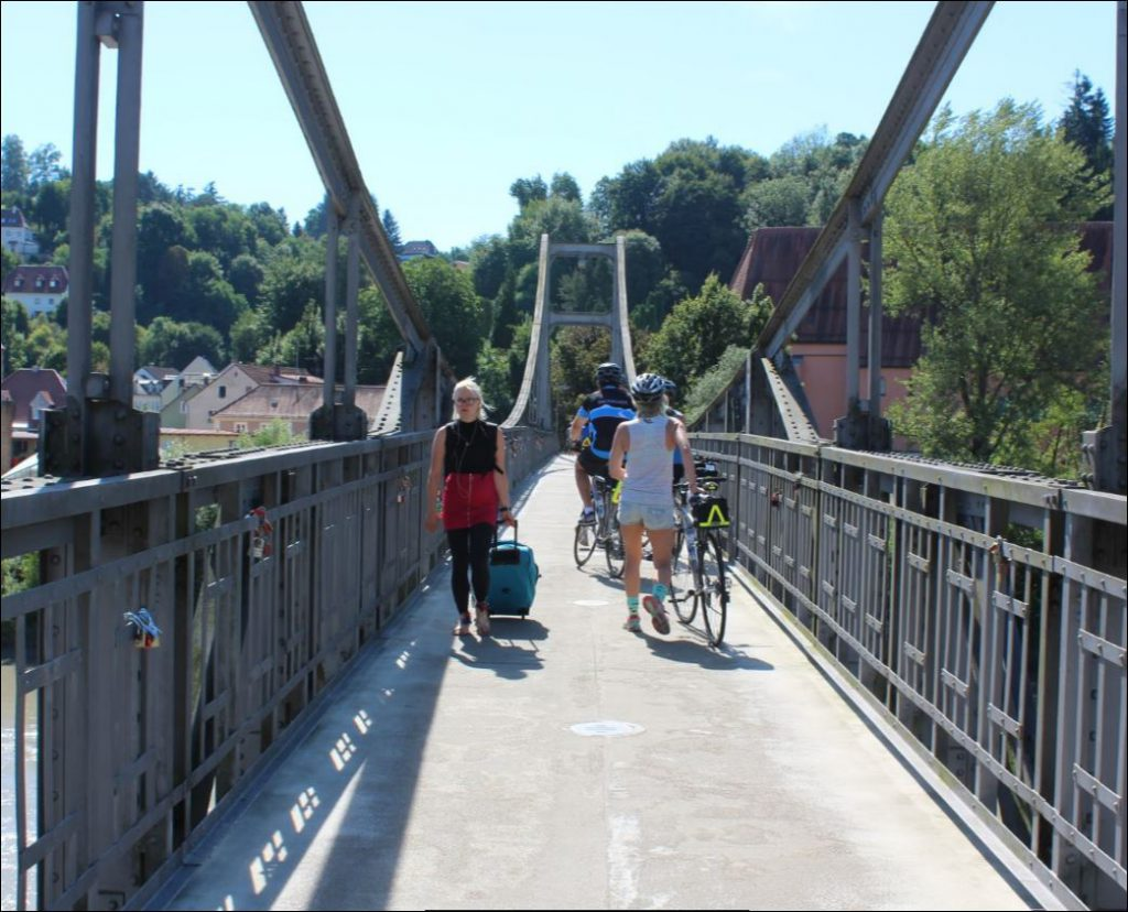 Crossing a pedestrian bridge on our final ride along the Danube