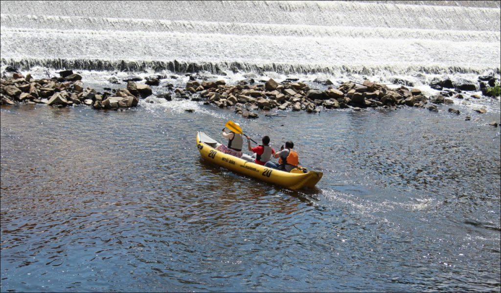 Kayakers playing in the waterworks in Old Cesky Krumlov