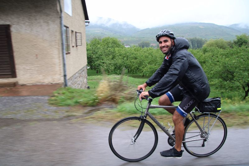 Our intrepid Backgroads guide Evan Thompson rding with a smile in the rain (photo by Virginia Meyer)
