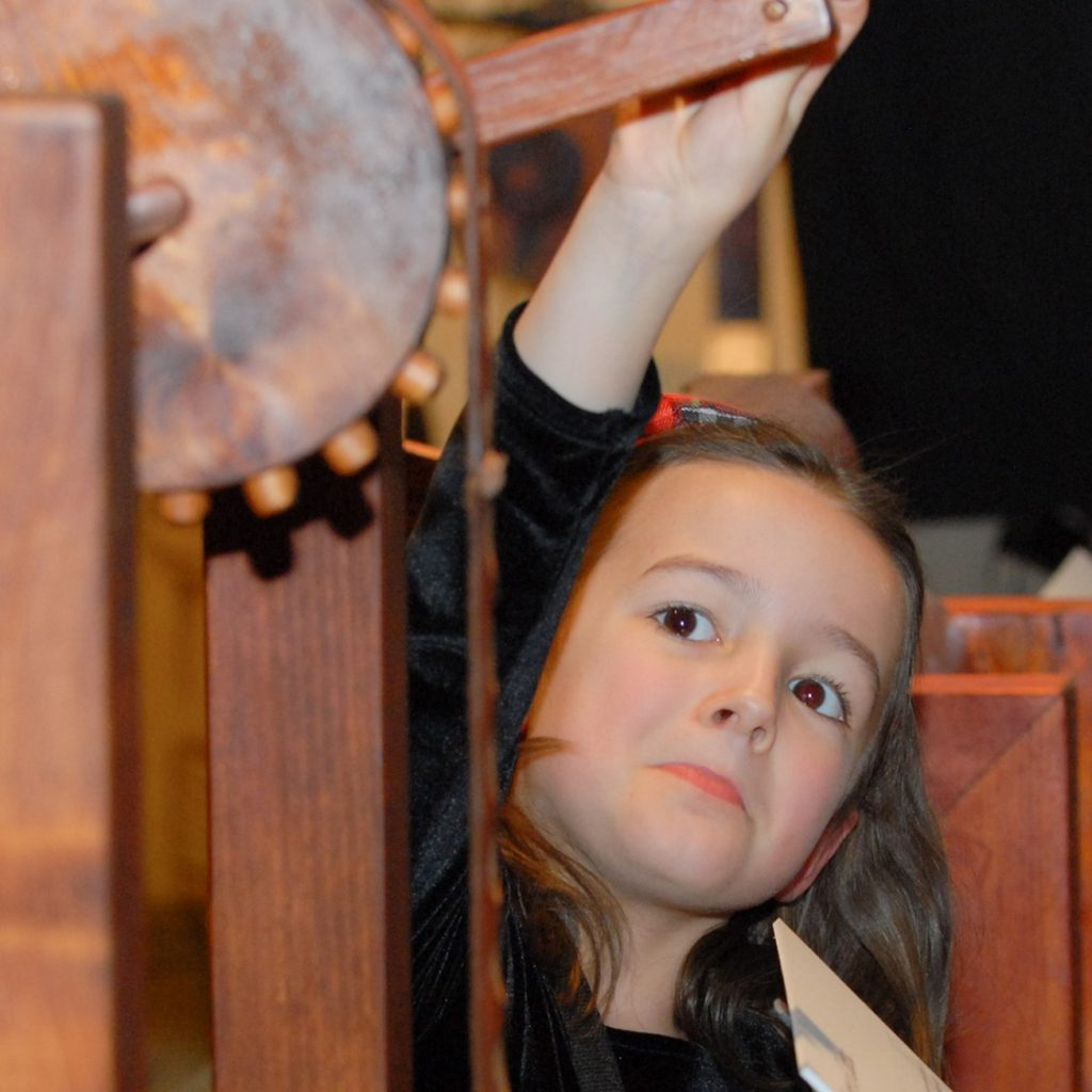 A young visitor investigates one of the many machines inspired by Leonardo's study of mechanical principles