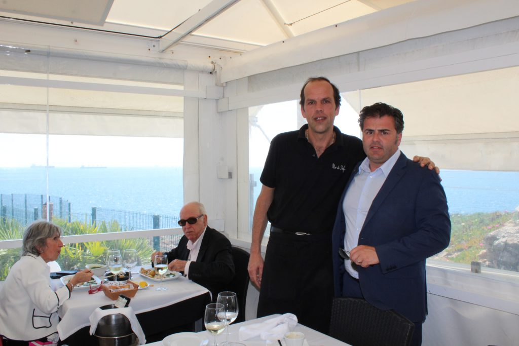 Tour guide Eduardo Nobre (right) with owner of Mar do Inferno restaurant