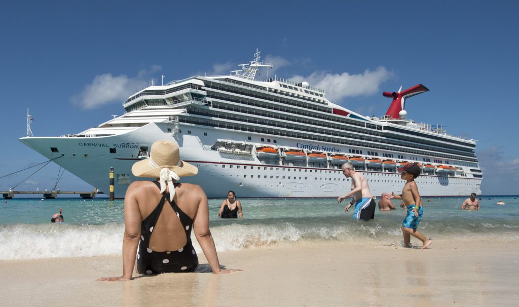 Guests enjoy the beach while the Carnival Sunrise is docked in Grand Turk in the Bahamas
