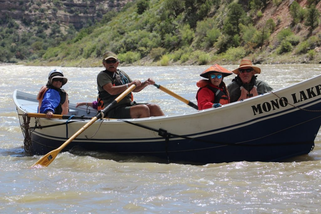 Doc Nicholson taking his Dory down the Yampa River