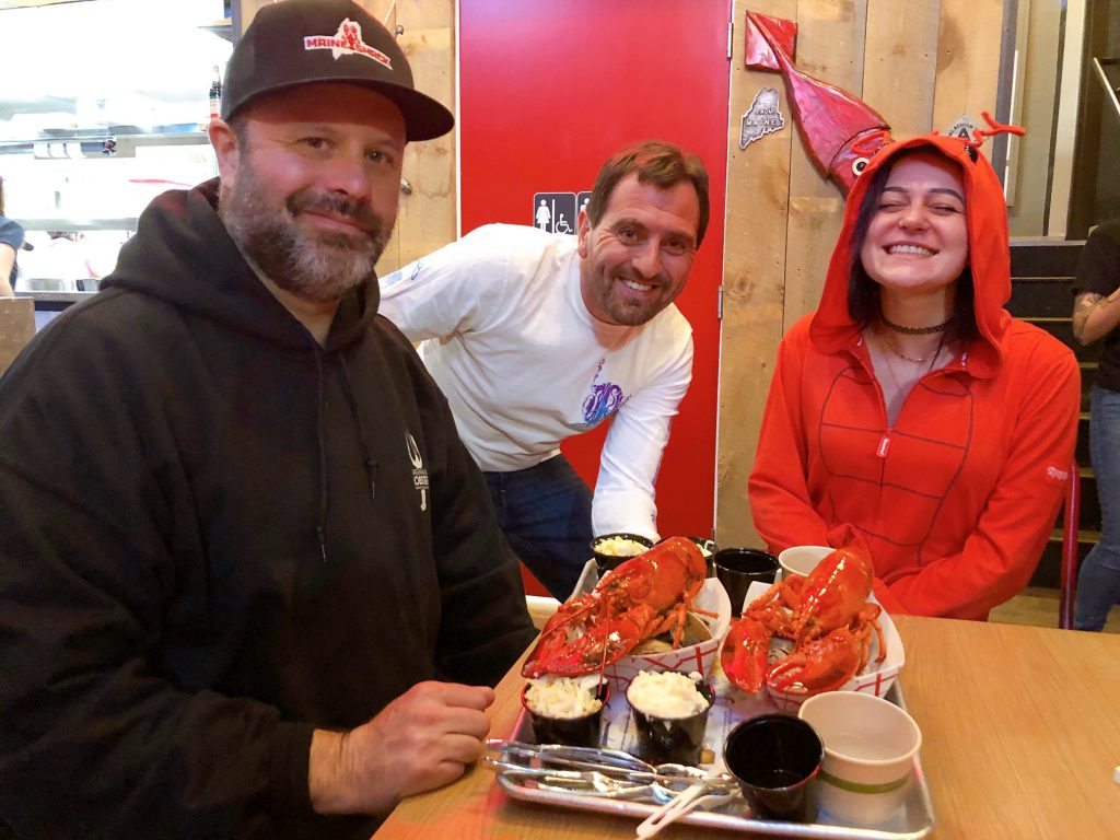 Maine Shack co-owners Drew Ryan and John Caprio serve up freshly cooked lobsters
