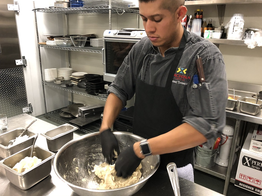 Chef Cesar hand mixes the masa dough for the tamales
