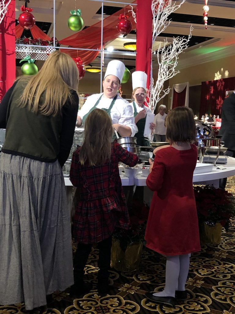 A family decided between crepe suzettes or bananas foster at Broadmoor Christmas Brunch