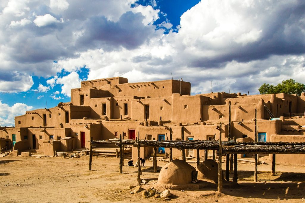 UNESCO World Heritage Site Taos Pueblo With Baking Ovens In Foreground