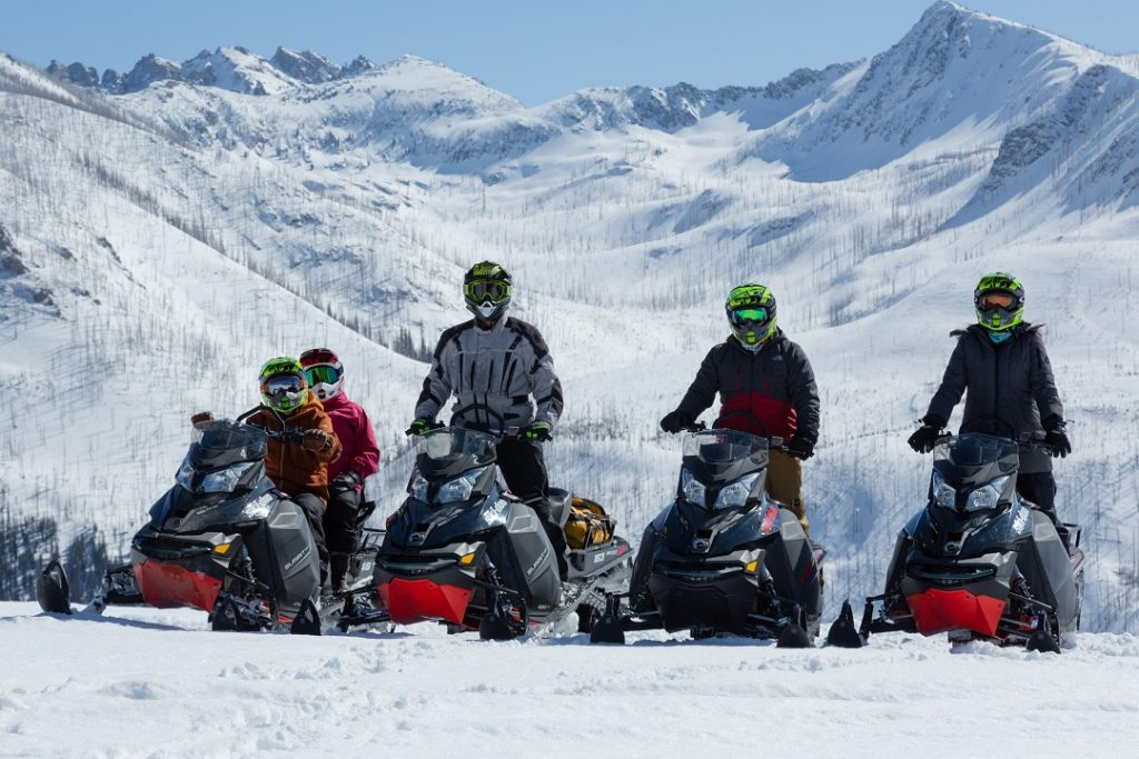 Our group on snowmobiles in the back country near Vista Verde Ranch