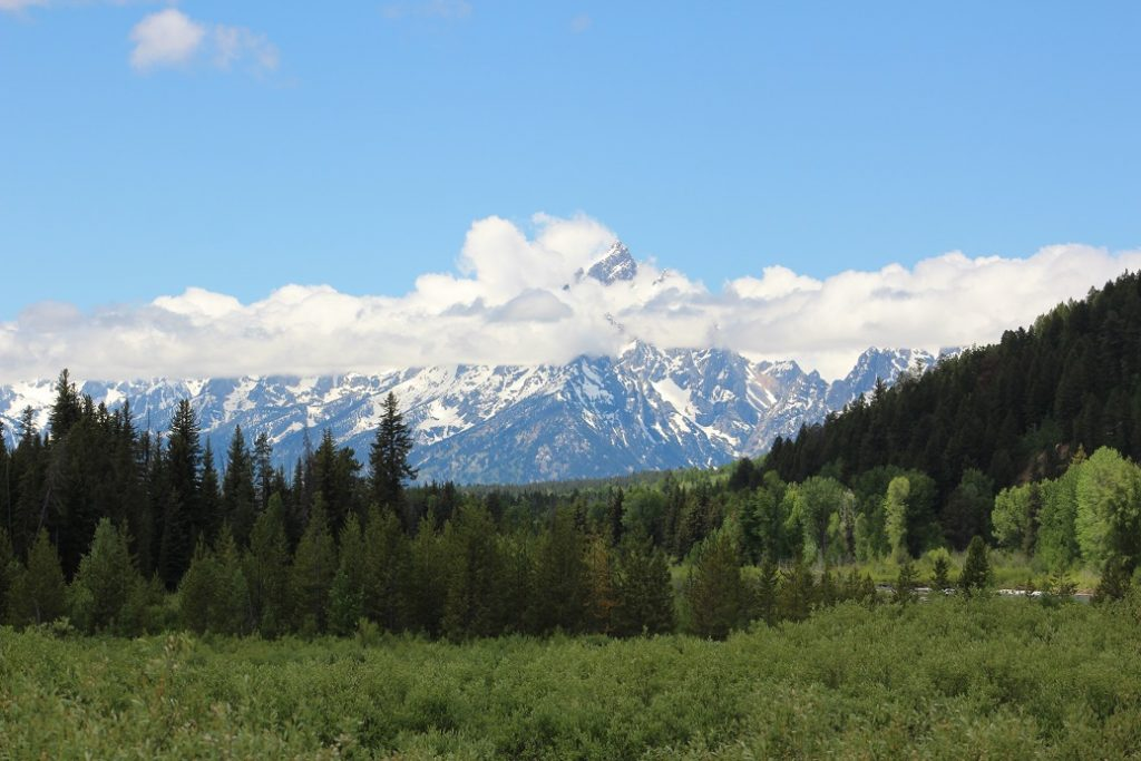 Clouds lift enough for a glimpse of Grand Teton mountain