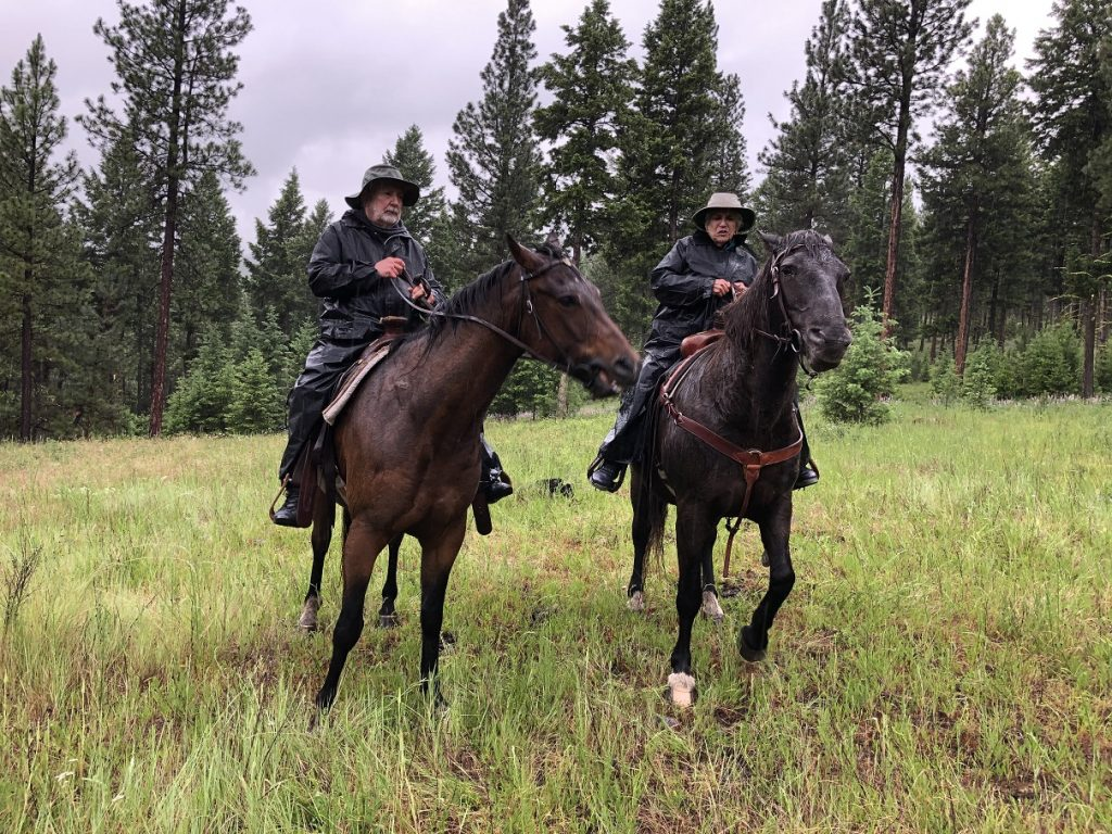 Our horseback ride in the rain at Paws Up