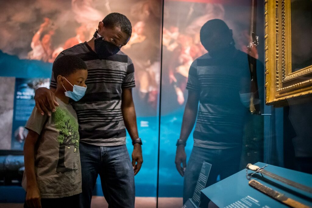 Museum goers safely navigating displays as AMR reopens. (Museum of the American Revolution)
