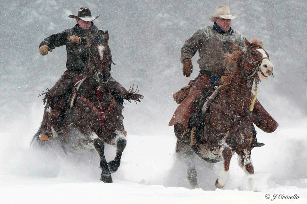 Wranglers at the Bar W Guest Ranch In Montana working in the snow