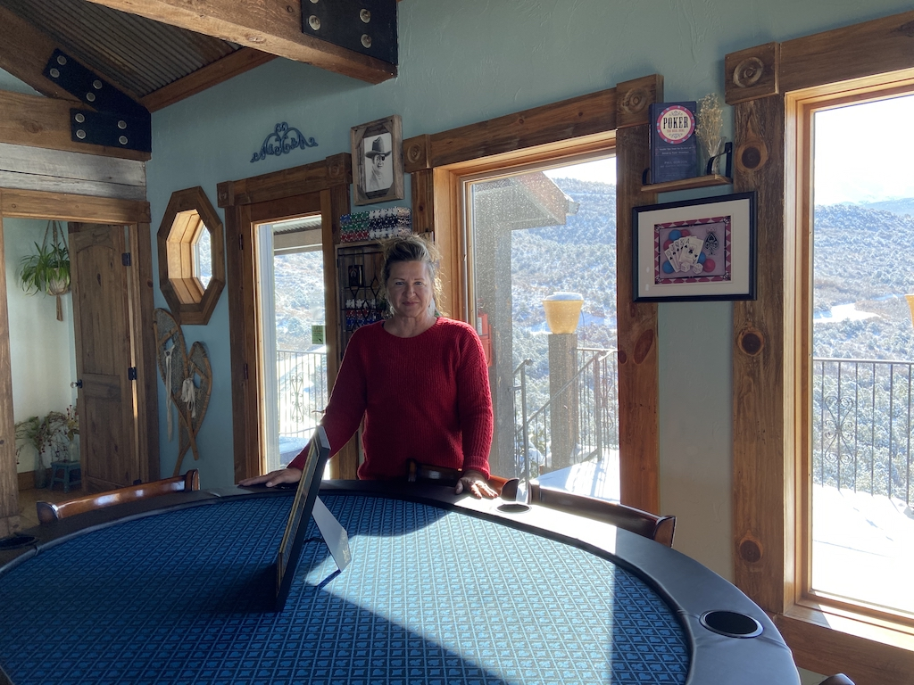 Kelly Shumway with the poker table she built for the Cedar Bend cabin at Whispering Oaks Ranch near Moab UT