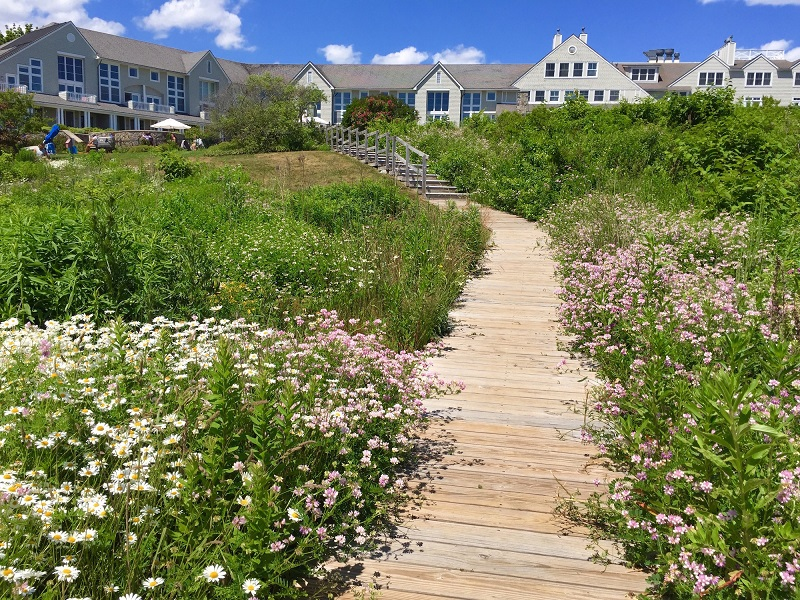 A private boardwalk leads from Inn by the Sea, ME to sandy Crescent Beach