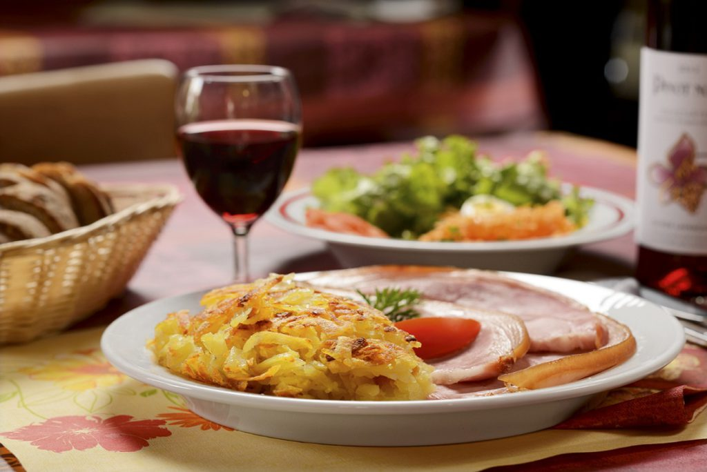 A tasty Rosti, made with grated fried potatoes and served with an egg, bacon and cheese