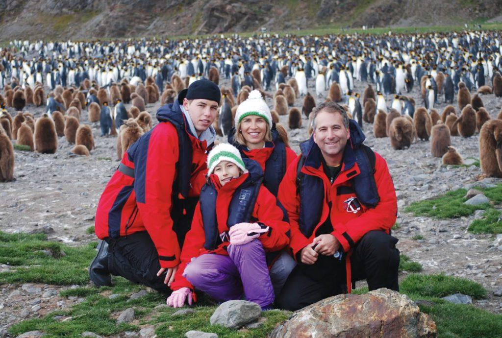 Family and penguins on South Georgia Island