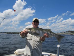 Andy with too-big-to-keep striped bass off Kennebunkport ME