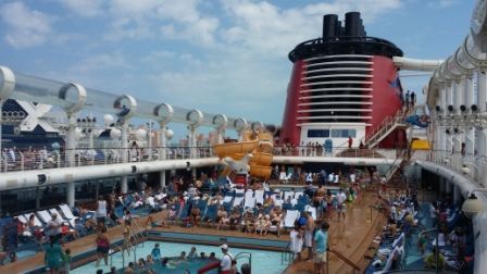 AquaDuck water slide loops around deck swimming pools and over the edge of the ship