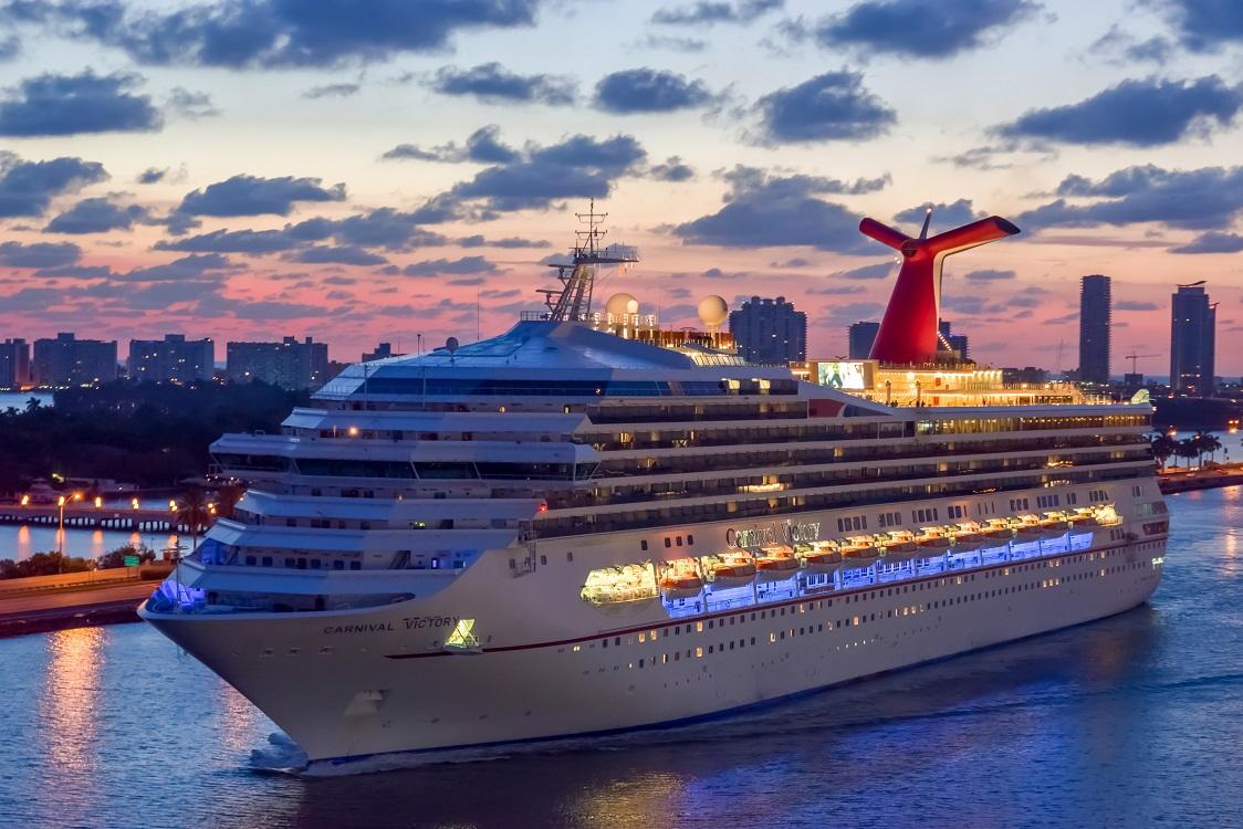 Carnival Cruise Ship sailing into the Port of Miami at sunrise