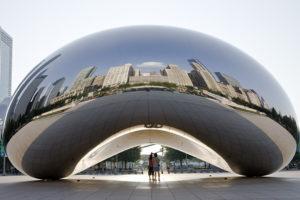 Chicago skyline reflects from Cloud Gate Sculpture at Millennium Park