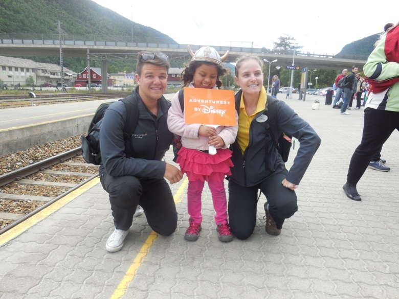 Disney guide Torgeir and Kira with 6-year-old Sara Sophia on ride to Oslo