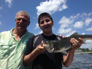 Enesi Domi and Captain Hebert show off his catch