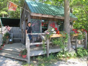 Enesi checks out the lobster prices at Wolfs near Kennebunkport ME
