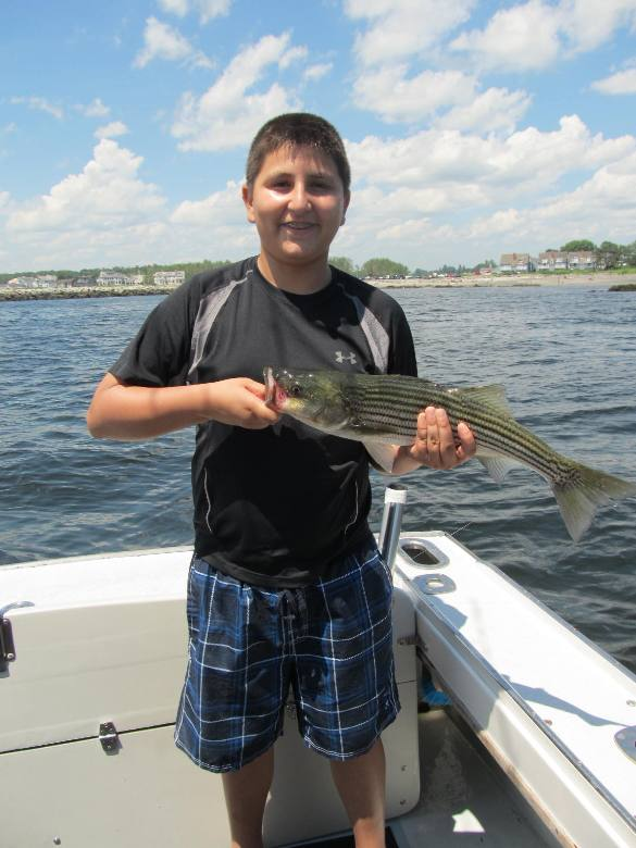 Enesi with his first fish caught ever off Kennebunkport ME