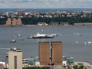 Enterprise being ferried to Intrepid Museum on the Hudson River