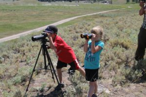 Ethan and Hannah viewing Yellowstone bear from a safe distance
