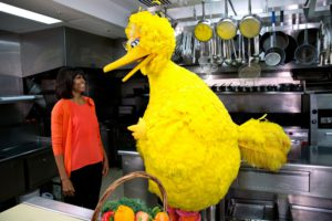 """First Lady Michelle Obama participates in a """"Let's Move!"""" and """"Sesame Street"""" public service announcement taping with Big Bird in the White House Kitchen"""