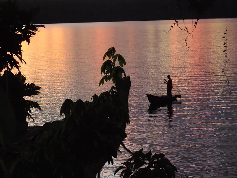 Fisherman casting net in sunset at Jicaro Island Ecolodge