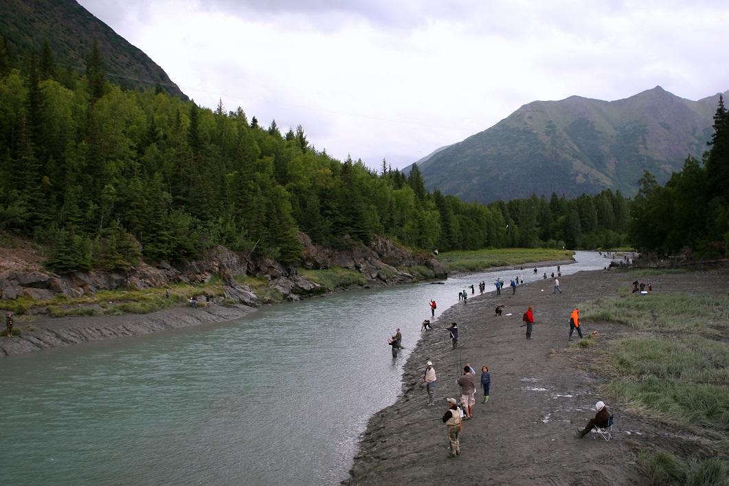 Fishing along the riverbank in Alaska