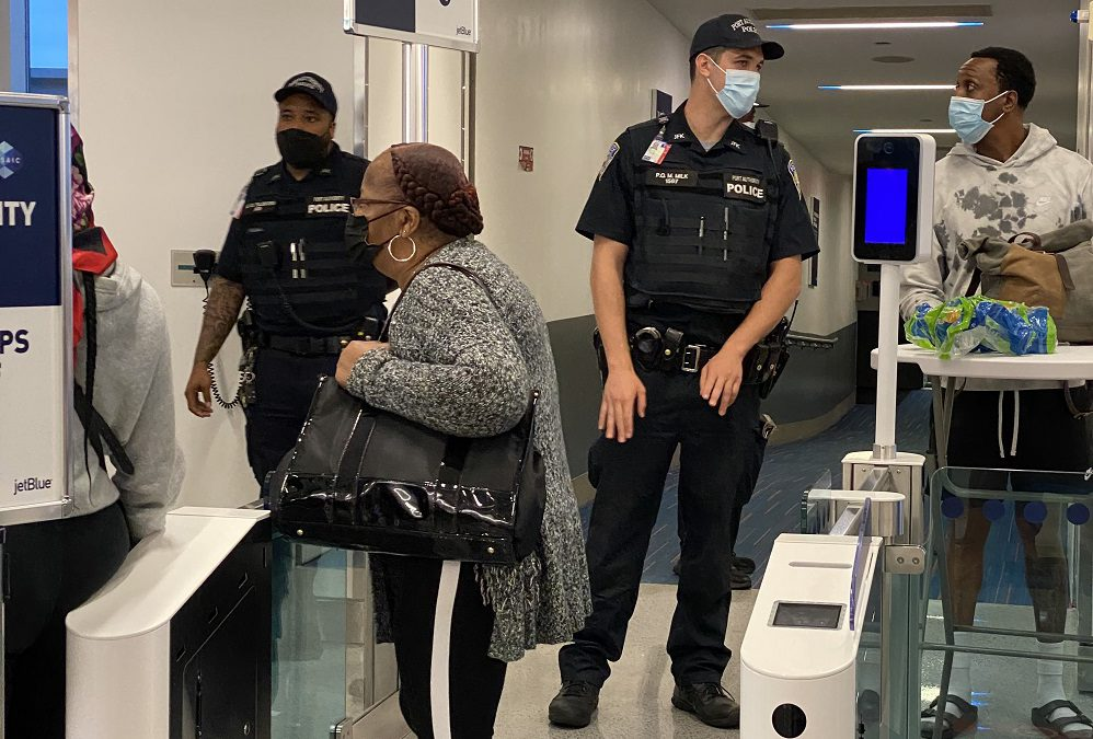 Armed police greet passengers after the THIRD JetBlue aircraft fails to depart