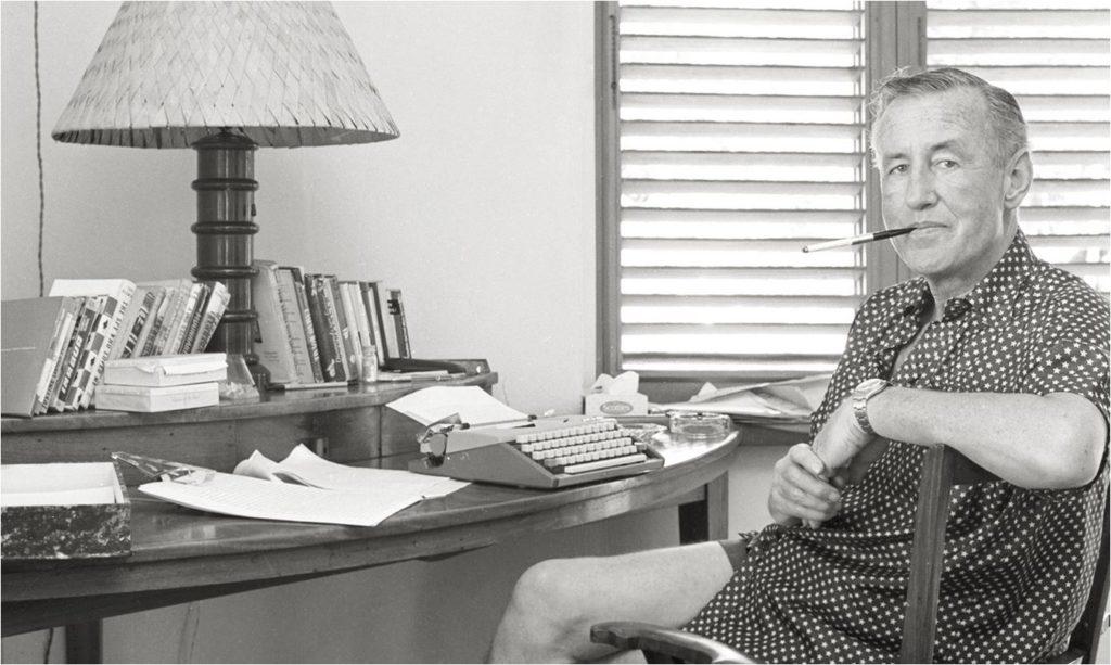 Ian Fleming at work on his James Bond novels (historical photo)