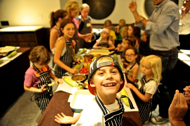 Families learning the culinary arts on vacation