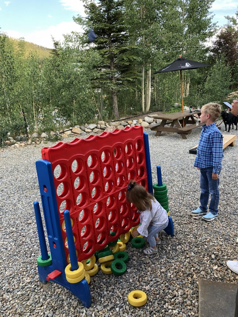 Kids playing outside the Breckenridge Distillery