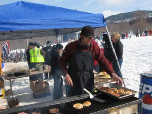 Larry Williams doing grill chores at Bolton Valley