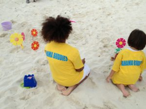 Local and visiting kid in Beach Buddies program on Abacos