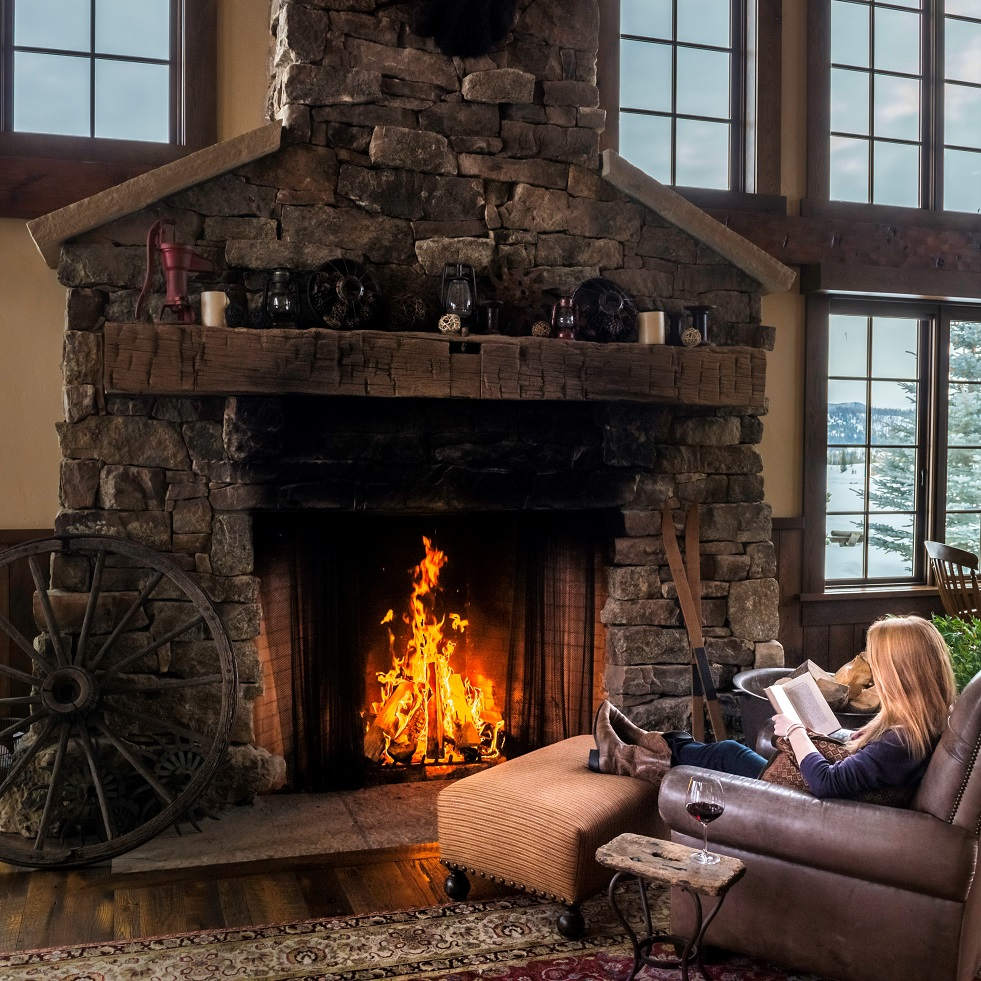 Lounging by the fireplace in the lodge at Vista Verde Ranch