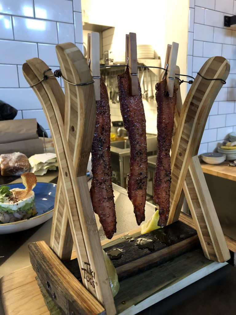 Maple Pepper Bacon served on a clothesline at Breckenridge Distillery
