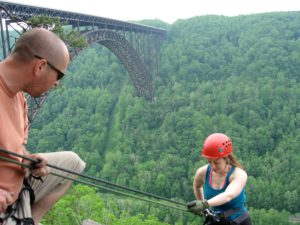 Meghan rappelling the bridge buttress