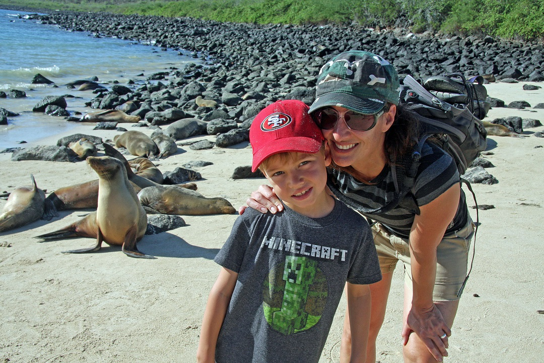 Mom and son visit sea lions in the Galapagos with AdventureSmith Explorations