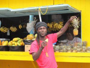 On the road near Curtain Bluff, an Antiguan enjoys local pineapple