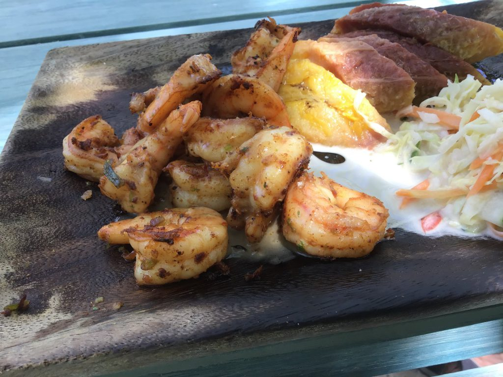 Grilled shrimp, slaw and roasted plantains for lunch on Button Beach