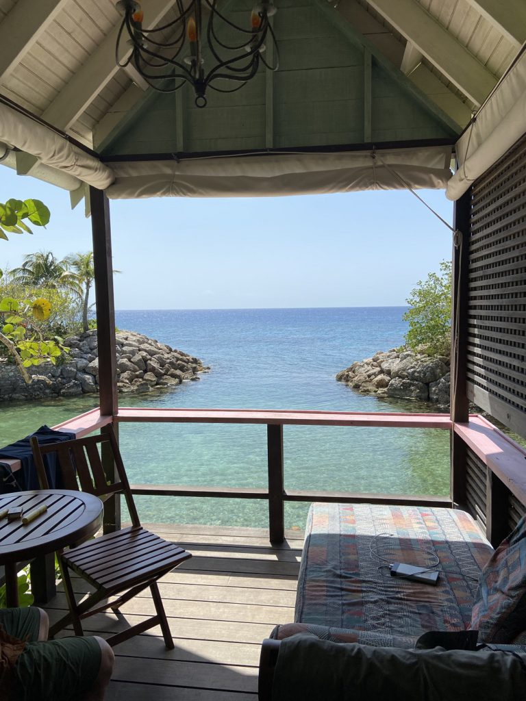 """View of """"snorklers cove"""" from one of the beach huts"""