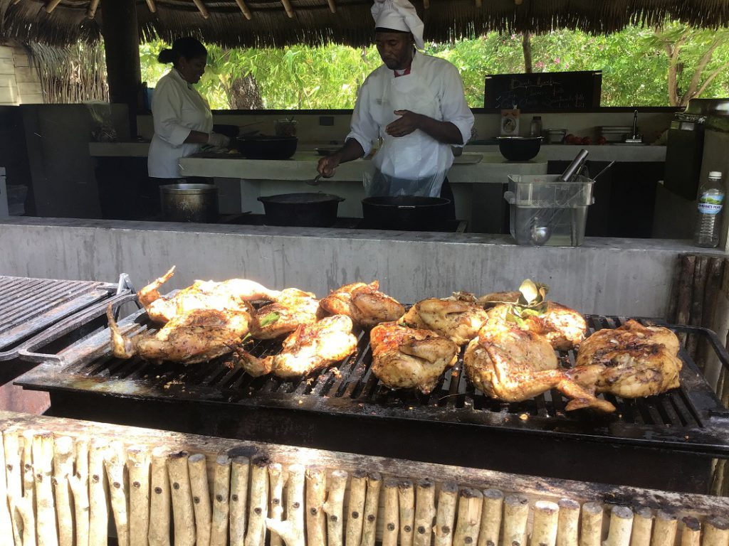Famous Jamaican Jerk Chicken on the grill at Button Beach