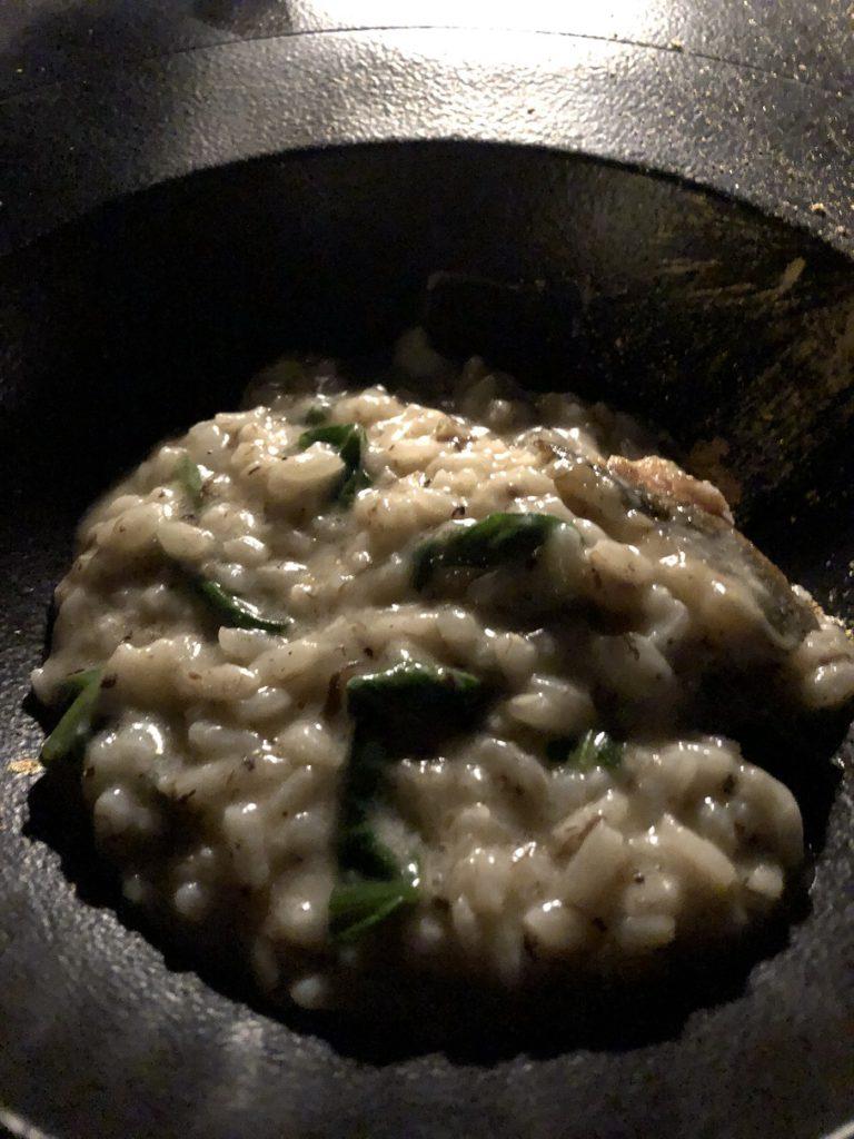 Delicious rissoto with branzino, spinach, truffle and gold powder