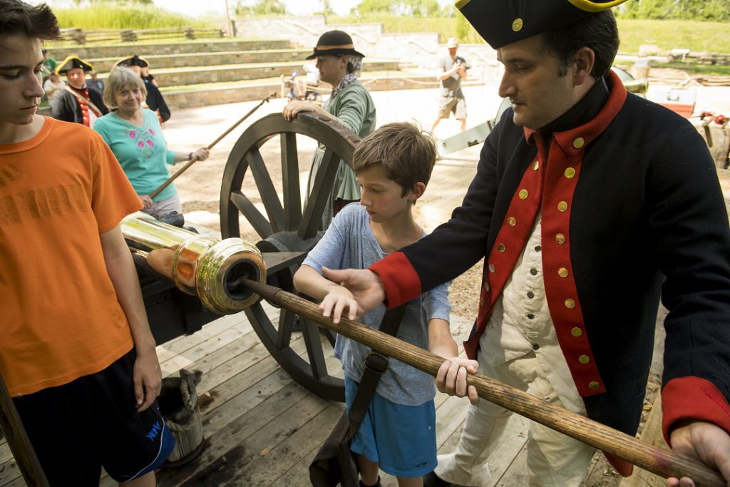 """Ramming the gun at the Blast from the Past"""" exhibit at the American Revolution Museum at Yorktown. (American Revolution Museum)"""